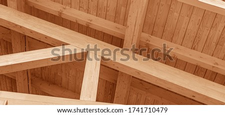 The construction of the wooden roof. Detailed photo of a wooden roof overlap construction. Royalty-Free Stock Photo #1741710479