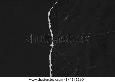 Old black paper texture. Grain texture backgound. Torn page Royalty-Free Stock Photo #1741711604