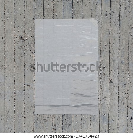 White crumpled paper wheatpaste poster on concrete wall background. Design element. #1741754423