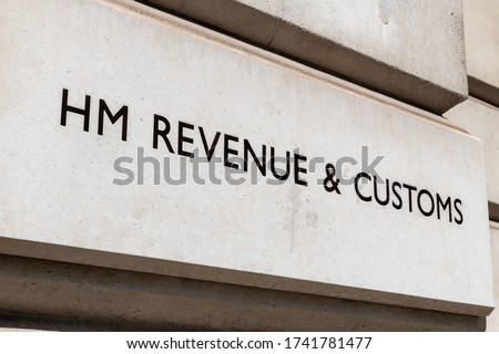 The engraved name/sign by the entrance to the government offices of HM Revenue and Customs. The department responsible for the collection of taxes, state support and other regulatory regimes.