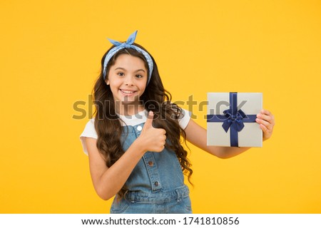 Childrens day. This is for you. Celebrate birthday. Kid birthday gift. Extra bonus. Grateful for good gift. Surprise and present box. Child smiling happy hold gift box. Kid girl delighted gift. #1741810856