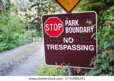 Stop; Park boundary; No Trespassing sign posted in Santa Cruz Mountains; California Royalty-Free Stock Photo #1741888241