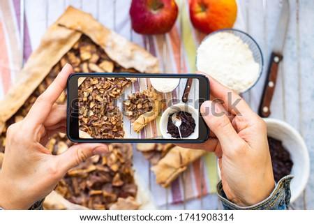 Phone photography of vegan food. Make picture of apple tart pie.