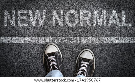 Concept of crossing from what used to be normal to New Normal after COVID-19 cornoavirus restrictions are lifted. Royalty-Free Stock Photo #1741950767