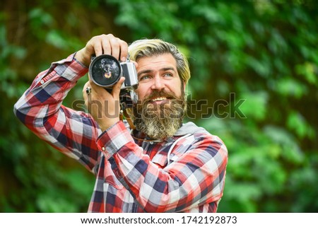 Sharing summer shots. man traveler with retro camera. photography in modern life. travel tips. professional photographer use vintage camera. bearded man hipster take photo. photo shooting outdoor.