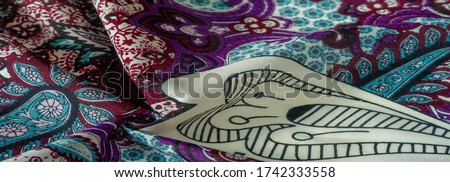 Background texture. cotton women scarf black and white pattern on one side of the scarf and color paisley pattern on the other side #1742333558