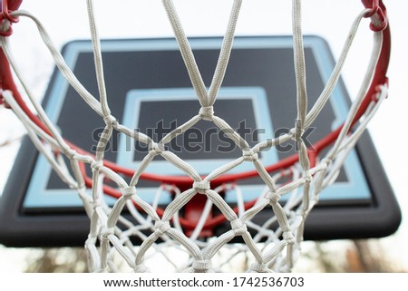 Close-up of basketball hoop and net outdoors in backyard
