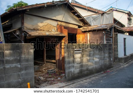 Japanese wooden house being demolished Royalty-Free Stock Photo #1742541701