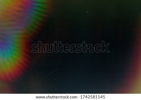 Designed film texture background with heavy grain, dust and a light leak Real Lens Flare Shot in Studio over Black Background. Easy to add as Overlay or Screen Filter over Photos overlay