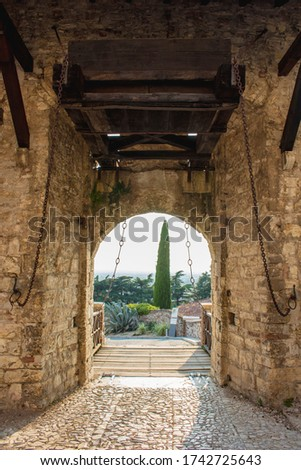 Close up. Medieval castle (Castello di Brescia) with battlements, a tower, drawbridge and ramparts. Lombardy, Italy #1742725643