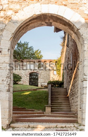 Close up. Medieval castle (Castello di Brescia) with battlements, a tower, drawbridge and ramparts. Lombardy, Italy #1742725649