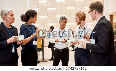 Group of businesspeople interacting during coffee break at business conference. Business, communication concept. Horizontal shot. Selective focus. Web Banner