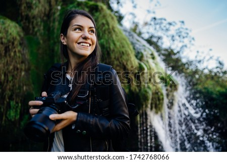 Woman tourist hiker visiting a mountain national park trail.Adventure tourist landscape photographer exploring nature.Nature and environment lover.Healthy lifestyle,enjoying outdoor active vacation