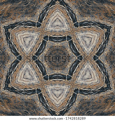 A kaleidoscope pattern formed by lines and spots of natural stone texture. Amazing natural patterns and textures of slice of brown and white minerals. The image with the mirror effect.