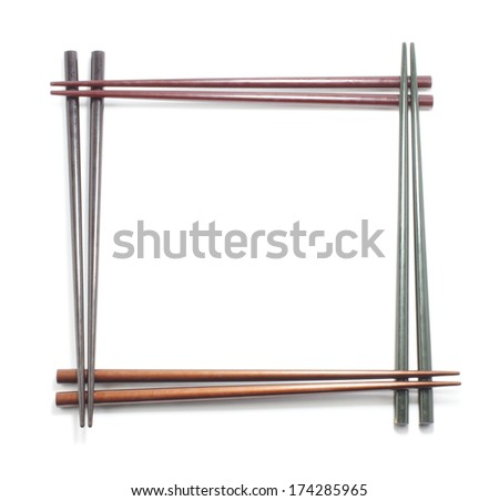 Decorative frame of color wood chopsticks isolated on a white