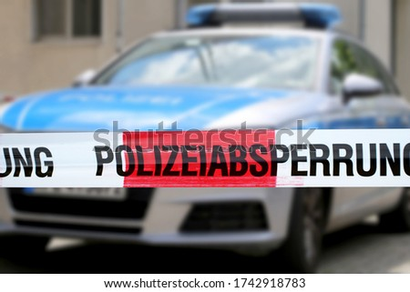 """Symbol image: Cordon tape with the word """"Polizeiabsperrung"""", the german word for police cordon"""