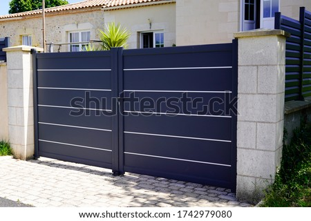 modern grey gate aluminum portal to home access Royalty-Free Stock Photo #1742979080