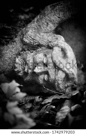The crucifixion of Jesus Christ. Very old and ancient stone destroyed statue. Black and white image.