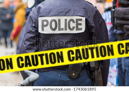 Police man and yellow tape, crime scene, caution - adhesive tape. Concept picture