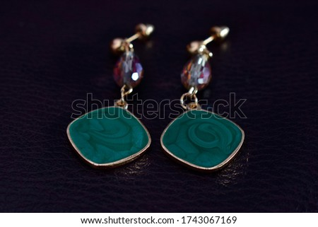 Opal Is a gold earring adorned with beautiful opal jewels.