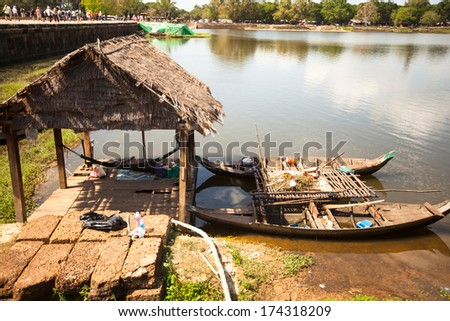 SIEM REAP, CAMBODIA - DEC 13: Angkor Wat - is the largest Hindu temple complex and religious monument in the world, Dec 13, 2012 Siem Reap, Cambodia. It is the country's prime attraction for visitors. #174318209