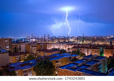 Lightning on the rooftops in the city