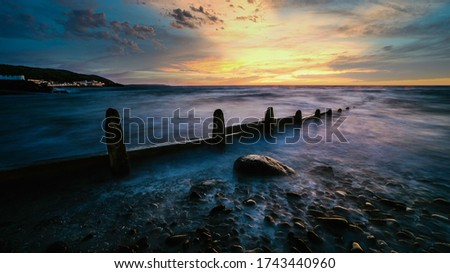Sunset at Westward Ho!  Shot from the Pebble Ridge. Royalty-Free Stock Photo #1743440960