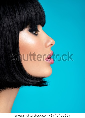 Glamour fashion model with black gloss make-up. Beautiful fashion woman with a bob hairstyle. Attractive white girl with black eye-makeup.  Stylish fashionable concept. Art.  #1743455687