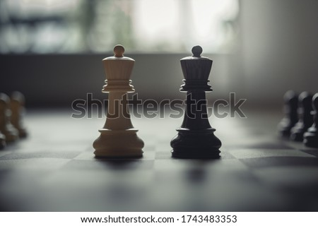 Business Talks And Negotations. Business Arenas In Modern Settings. Kings Face Each Other On The Chess Battlefields. Royalty-Free Stock Photo #1743483353