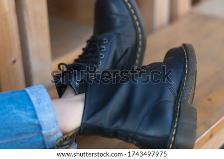 Black lace up combat boots Royalty-Free Stock Photo #1743497975