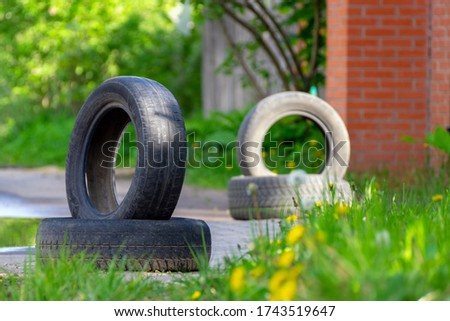 used car tires are used to indicate the boundaries of the road #1743519647
