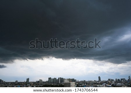 Pictures of heavy rain and stormy clouds In the modern city