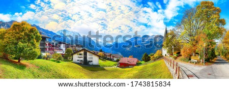 Awesome autumn view of picturesque alpine village Wengen.  Sunny morning scene of Swiss Alps. Location: Wengen village, Berner Oberland, Switzerland, Europe. Royalty-Free Stock Photo #1743815834