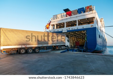 Ferry and Trucking Transportation - RO-RO Transport (Roll On/Roll Off) Royalty-Free Stock Photo #1743846623