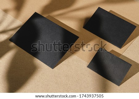 Black business cards on cork board table