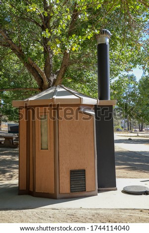 A campground pit toilet outhouse.