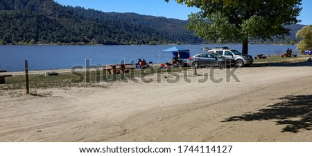 View of people having a picnic and enjoying the view of the lake at Lake Hemet in California.