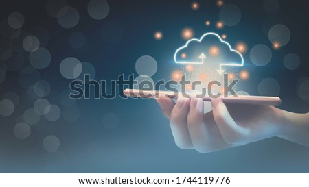 Futuristic cloud computing storage system concept,business woman hand holding smartphone,with interface cloud icon,connect to data base station and operations,use artificial intelligence or AI system. Royalty-Free Stock Photo #1744119776