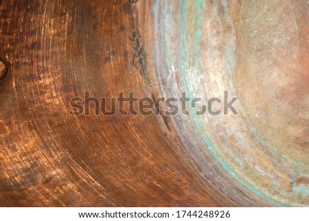Copper surface of the inner wall of the copper pot. Green circles of copper oxidation. Copy space. #1744248926