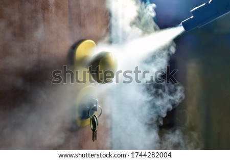 steam processing of keys and door handles, disinfection Royalty-Free Stock Photo #1744282004