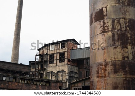 Hlubina mine, The Lower Vitkovice area, Ostrava, Czech Republic / Czechia - ruin of abandoned old historical industrial budiling. Architecture is desolated, corroded and ruined. Royalty-Free Stock Photo #1744344560