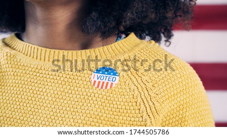 Young Gen Z Voter Wearing Sticker After Voting in Election #1744505786