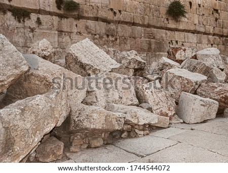 closeup of stones thrown from the second temple to the street below after the destruction of the temple in 70 CE Royalty-Free Stock Photo #1744544072