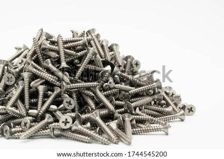 tapping screws made od steel, metal screw, iron screw, chrome screw, screws as a background, wood screw,on white background Royalty-Free Stock Photo #1744545200