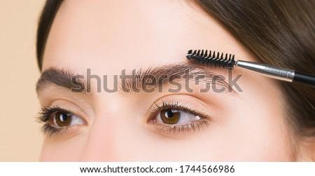 Eyebrows correction. Shape. Perfect natural eyebrows and eyelashes. Lush eyebrow. Natural make up. Beauty. Eyebrows and eyelashes close up Royalty-Free Stock Photo #1744566986
