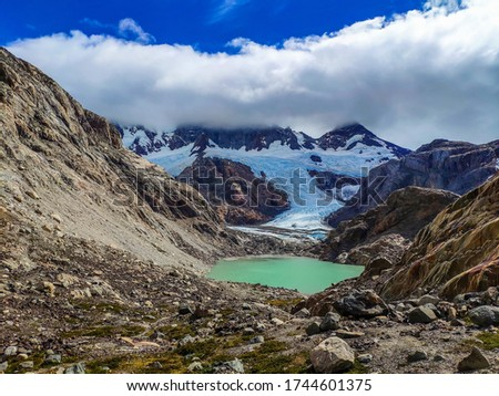 Glacier lake between snowy mountains in Argentine Patagonia