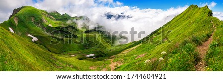 Panoramic majestic view on grasslands on the Bavarian Alps with blue sky and white clouds Royalty-Free Stock Photo #1744604921