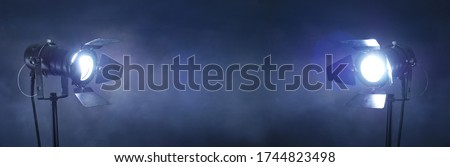 A panoramic live show event grunge background, with studio spotlights and copy space