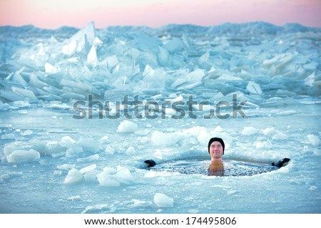 Winter swimming. Man in an ice-hole #174495806