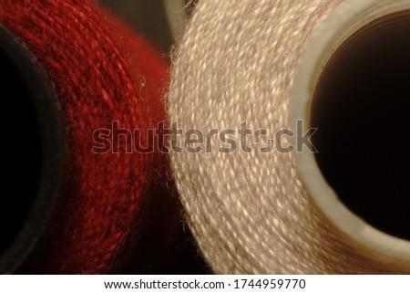 Sewing thread spool macro photo. #1744959770